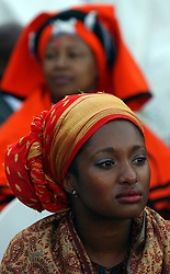 PRETORIA, SOUTH AFRICA - APRIL-27-2004 - An African women dressed in traditional clothes at the inauguration ceremony for South African President Thabo Mbeki , which marks the 10th Anniversary of the fall of Apartheid in South Africa. (PHOTO © JOCK FISTICK)
