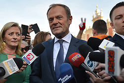 October 6, 2018 - Krakow, Poland - Donald Tusk, the President of the European Council, with Marek Sowa, during a walk in Krakow's Market Square after the 18th International Conference 'The role of the Catholic Church in the process of European integration' organised in the International Cultural Center..On Saturday, October 6, 2018, in Krakow, Poland. (Credit Image: © Artur Widak/NurPhoto/ZUMA Press)