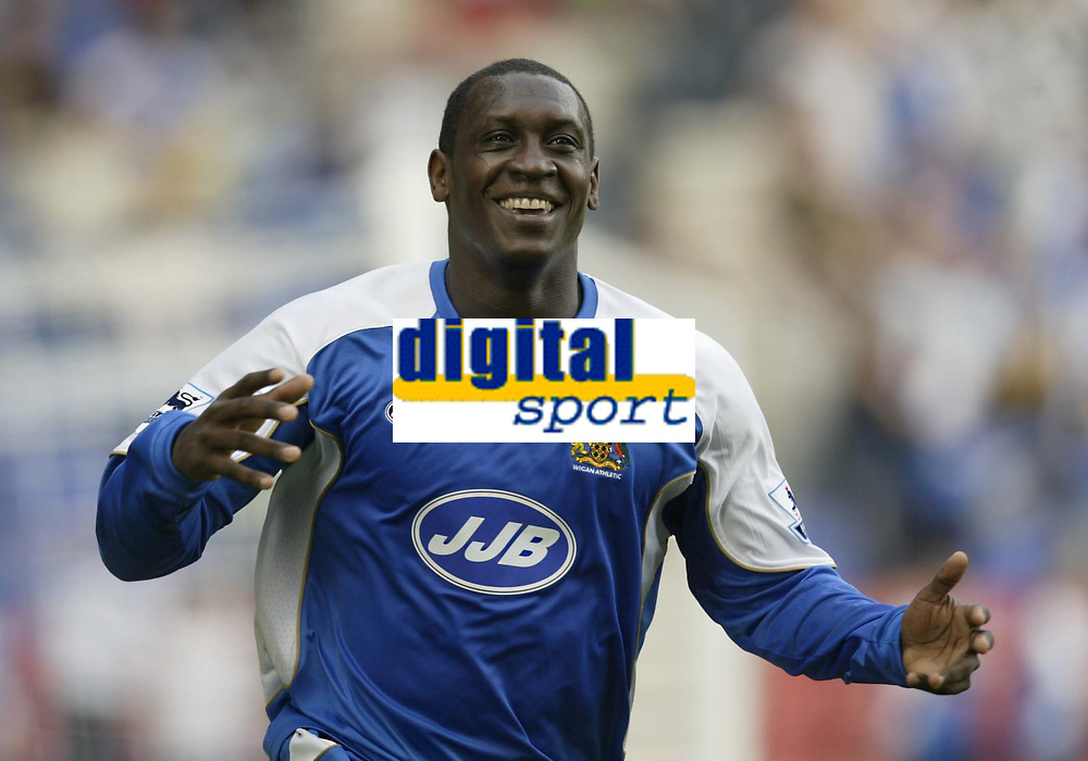 Photo: Aidan Ellis.<br /> Wigan Athletic v Reading. The Barclays Premiership. 26/08/2006.<br /> Wigan's Emile Heskey celebrates his goal the first of the game