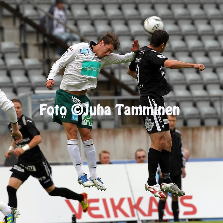 16.7.2012, Hiihtostadion, Lahti..Veikkausliiga 2012..FC Lahti - IFK Mariehamn..Mason Trafford (IFK Mhamn) v Rafael (FC Lahti).