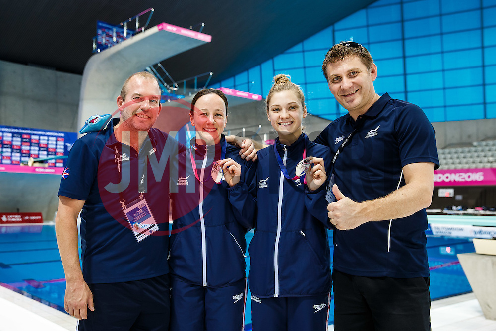 Rebecca Gallantree and Alicia Blagg of Great Britain celebrate with their coaches Edwin Jongejans (L) and Ady Hinchcliffe (R) after winning Silver Medals in the Womens 3m Synchronised Springboard - Mandatory byline: Rogan Thomson/JMP - 15/05/2016 - DIVING - London Aquatics Centre - Stratford, London, England - LEN European Aquatics Championships 2016 Day 7.