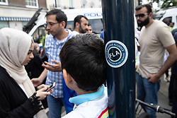 © Licensed to London News Pictures. 10/06/2018. London, UK. A sticker supporting the Football Lads Alliance ( FLA ) left on a lamppost outside the Saudi Arabian embassy at the scene of the annual Al Quds day march in support of the Palestinian cause, in central London. Photo credit: Joel Goodman/LNP