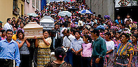 Guatemala San Raymundo, The caskets are carried out of the church for the two Presidential Candidate, and Nobel Peace Prize winner, Rigoberta Menchu campaign workers, who were found murdered earlier in the week in San Raymundo Guatemala, Friday Sept 7, 2007.  Crime has become a serious issue in the upcoming elections that are to take place on Sept. 9 2007.  ..........