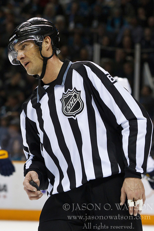 January 6, 2011; San Jose, CA, USA; NHL linesman Ryan Galloway (82) before a face off between the San Jose Sharks and the Buffalo Sabres during the first period at HP Pavilion. Buffalo defeated San Jose 3-0. Mandatory Credit: Jason O. Watson / US PRESSWIRE