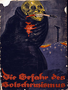 Die Gefahr des Bolschewismus': World War I German Poster, shows a skeleton, wrapped in a black cloak, with a bloody knife held in its teeth. In the background a hill of crosses on top of which is a gallows. Text: 'The danger of Bolshevism'.