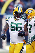 Green Bay Packers outside linebacker Julius Peppers (56) celebrates after recovering a fumble after a strip sack for a third quarter loss of 8 yards at the Bears 17 yard line during the 2016 NFL week 15 regular season football game against the Chicago Bears on Sunday, Dec. 18, 2016 in Chicago. The Packers won the game 30-27. (©Paul Anthony Spinelli)