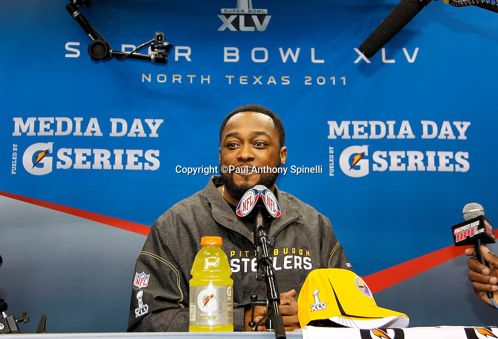 Pittsburgh Steelers head coach Mike Tomlin smiles as he speaks to the press at Super Bowl XLV media day prior to NFL Super Bowl XLV against the Green Bay Packers. Media day was held on Tuesday, February 1, 2011 in Arlington, Texas. ©Paul Anthony Spinelli
