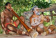 KURANDA, AUSTRALIA - NOVEMBER 07, 2007: Unidentified aborigine actors perform music with traditional instruments in the Tjapukai Culture Park in Kuranda, Queensland, Australia.