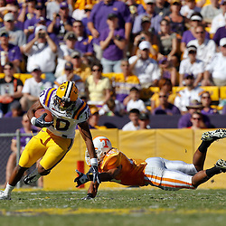 Oct 2, 2010; Baton Rouge, LA, USA; LSU Tigers wide receiver Russell Shepard (10) runs past Tennessee Volunteers cornerback Janzen Jackson (15) during the first half at Tiger Stadium.  Mandatory Credit: Derick E. Hingle