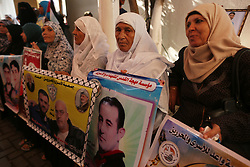 September 11, 2017 - Gaza, Palestinian Territories, Palestine - Palestinians take part in a protest to show solidarity with Palestinian prisoners held in Israeli jails, in front of Red cross office in Gaza city on Sept. 10, 2017  (Credit Image: © Momen Faiz/NurPhoto via ZUMA Press)