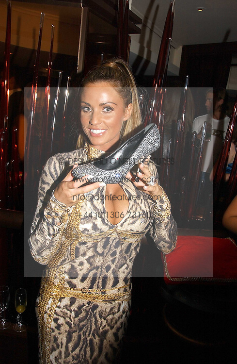 KATIE PRICE - model Jordan at a party to celebrate the 50th Anniversary of Gina Shoes held at The Bar, The Dorchester, Park Lane, London on 19th September 2006.<br />