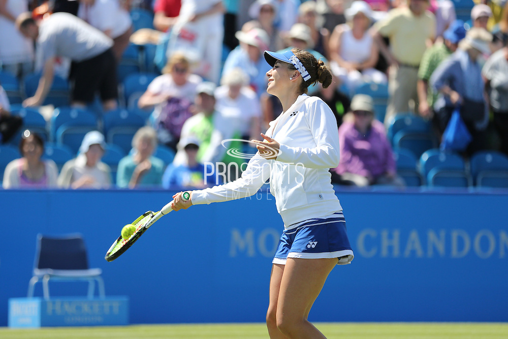 Belinda Bencic of Switzerland in the warm up with ball glued to the racket during the Aegon International Quarter Final match between Andrea Petkovic and Caroline Wozniacki at Devonshire Park, Eastbourne, United Kingdom on 25 June 2015. Photo by Phil Duncan.