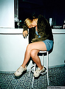 Drunk girl passed out on a stool at the Cream pre party Ibiza 1999