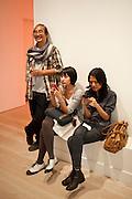 Haris Purnomo; ISHA HENING; AIRI WULAN, Indonesian Eye Contemporary Art Exhibition Reception, Saatchi Gallery. London. 9 September 2011. <br /> <br />  , -DO NOT ARCHIVE-© Copyright Photograph by Dafydd Jones. 248 Clapham Rd. London SW9 0PZ. Tel 0207 820 0771. www.dafjones.com.