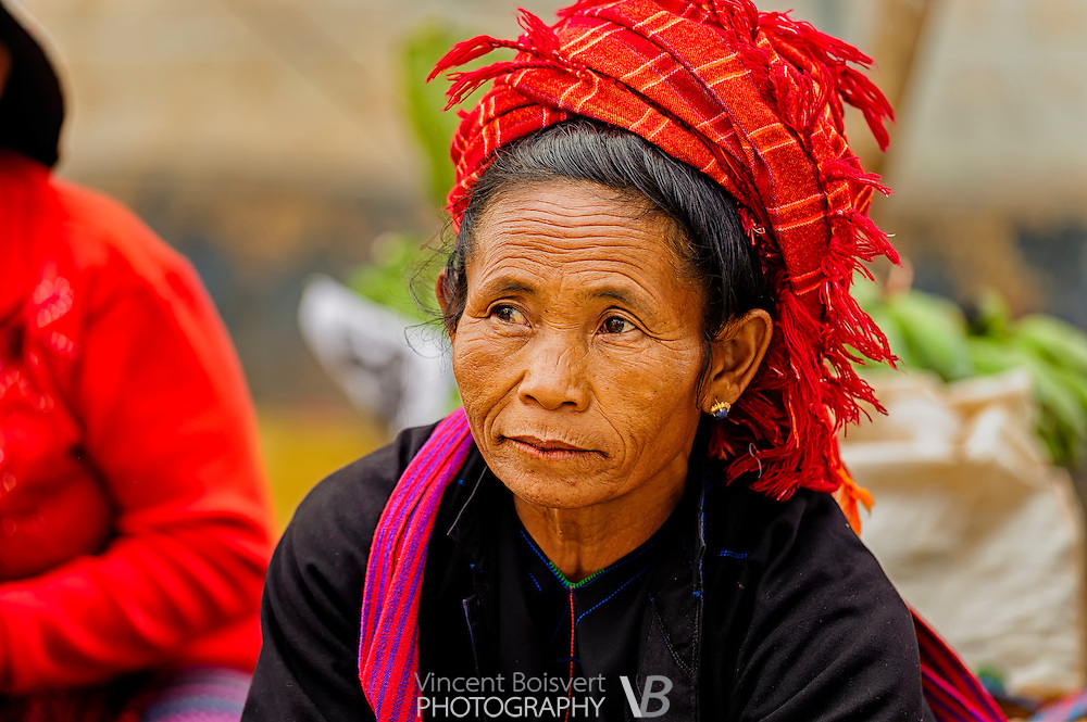 a Shan woman wearing a red scarf on a market day in kalaw, myanmar