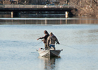 """The Poulin brothers take to the Winnipesaukee River in their """"Fishing Machine""""  during opening day of landlocked fishing season Wednesday morning.  (Karen Bobotas/for the Laconia Daily Sun)"""