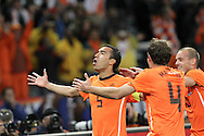 CAPE TOWN, SOUTH AFRICA- Tuesday 6 July 2010, Giovanni van Bronckhorst celebrates his goal during the semi final match between Uruguay and the Netherlands (Holland) held at the Cape Town Stadium in Green Point during the 2010 FIFA World Cup..Photo by Roger Sedres/Image SA