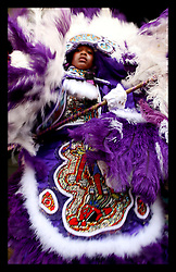 April 30th, 2006. New Orleans, Louisiana. Jazzfest . The New Orleans Jazz and Heritage festival. A child dressed in traditional Mardi Gras Indian costume dances on the Jazz and Heritage stage.