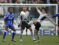 Photo: Lee Earle.<br /> Millwall v Everton. The FA Cup. 07/01/2006. Everton's Tim Cahill (R) clears the ball as Marvin Williams (L) and Matteo Ferrari watch on.