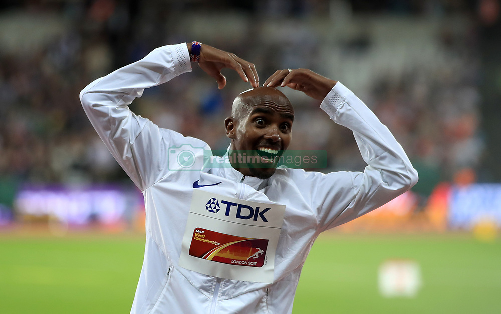Great Britain's Mo Farah celebrates before receiving his gold medal after winning the men's 10,000 metre final during day one of the 2017 IAAF World Championships at the London Stadium.