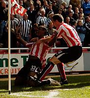 Photo: Jed Wee.<br />Sunderland v Newcastle United. The Barclays Premiership. 17/04/2006.<br /><br />Sunderland's Justin Hoyte (L) celebrates after scoring the opening goal.