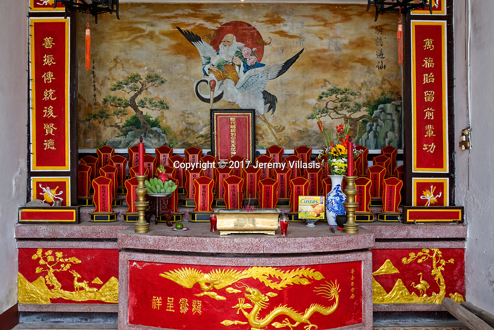 A small altar to honor the ancient ancestors at the Quang Trieu (Cantonese) Assembly Hall in Hoi An, Vietnam.