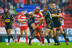 Wigan, England - Thursday, July 12, 2007: Wigan Warriors' Iafeta Paleaaesina charges through the Leeds Rhinos defence during the Super League match at the JJB Stadium. (Photo by David Rawcliffe/Propaganda)
