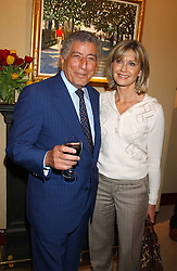 TONY BENNETT and OLIVIA NEWTON-JOHN at a private view of paintings by singer Tony Bennett held at the catto Gallery, 100 Heath Street, London NW3 on 5th April 2005.<br />