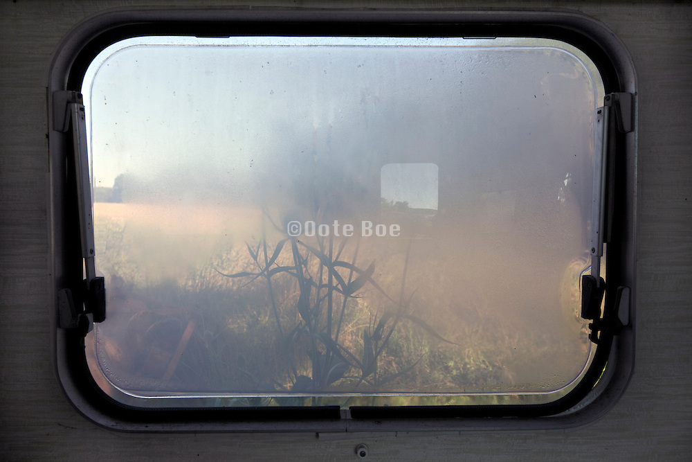 fogged up window from a camper seen from the inside