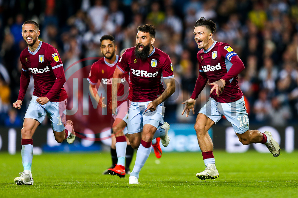 Jack Grealish of Aston Villa runs with Mile Jedinak and Conor Hourihane as the players celebrate after Aston Villa win the game on penalties to reach the Sky Bet Championship Final at Wembley - Rogan/JMP - 14/05/2019 - The Hawthornes - West Bromwich, England - West Bromwich Albion v Aston Villa - Sky Bet Championship Play-Off Semi Final Leg 2.