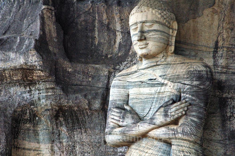 Sri Lanka, Polunnaruwa, 2006. At Polonnaruwa's Gal Vihara, or temple, representation of the impossible in stone: Buddha's serenity of being.