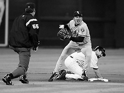White Sox second baseman Tadahito Iguchi makes the relay throw over Astros Brad Ausmus to double up Adam Everett who hit to Joe Crede in the 5th inning. Umpire is Angel Hernandez.