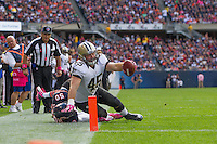 06 October 2013: Fullback (45) Jed Collins of the New Orleans Saints runs the ball near the goal line before being tackled by (50) James Anderson of the Chicago Bears during the first half of the Saints 26-18 victory over the Bears in an NFL Game at Soldier Field in Chicago, IL.