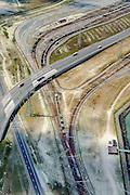 Nederland, Zuid-Holland, Rotterdam, 10-06-2015;  Europaweg, N15 naar Maasvlakte. Goederentrein op de sporen van de Betuweroute, richting Emplacement Maasvlakte. De weg rechtdoor is de Maasvlakteweg, richting Tweede Maasvlakte<br /> Road and rail infrastructure leading to Maasvlakte and second Maasvlakte, the new extension of the Port of Rotterdam.<br /> luchtfoto (toeslag op standard tarieven);<br /> aerial photo (additional fee required);<br /> copyright foto/photo Siebe Swart
