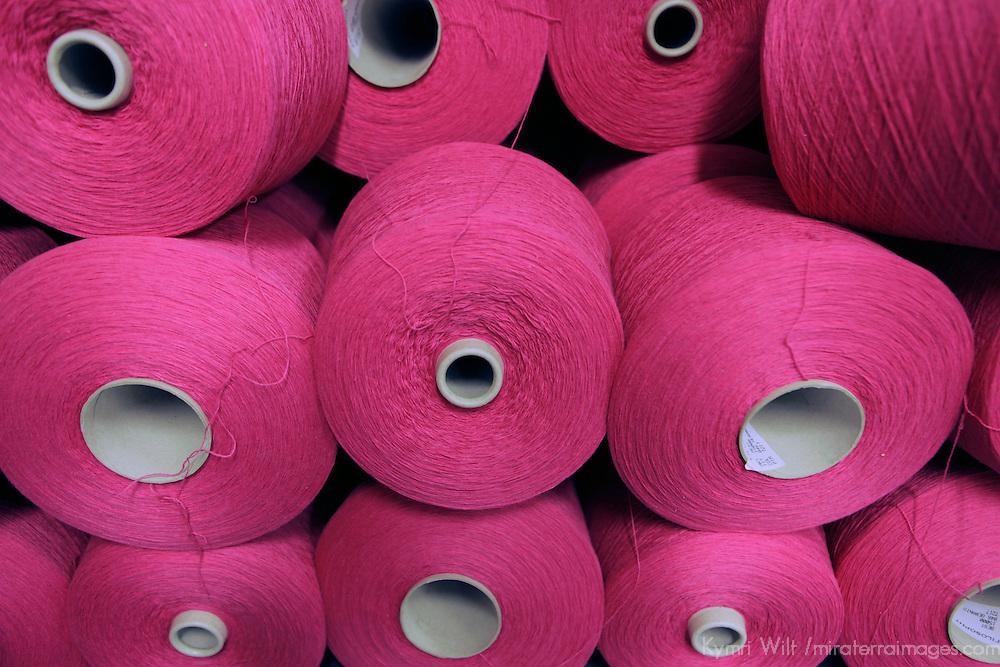 Europe, Ireland, Avoca. Magenta spools of wool at Avoca Handweavers Mill, County Wicklow.