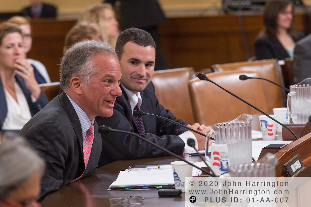 """Gary Cohen, Deputy Administrator and Director, Consumer Information and Insurance Oversight at the U.S. Department of Health and Human Services (left) testifies as Daniel Werfel, Principal Deputy Commissioner for Services and Enforcement at the Internal Revenue Service (right) looks on during the House Committee on Ways and Means hearing on """"The Status of the Affordable Care Act Implementation"""" on Capitol Hill in Washington, DC August 1, 2013."""