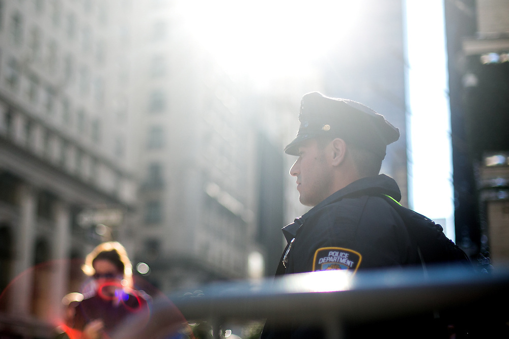 NEW YORK, NY - DECEMBER 5, 2016:  An NYPD officer stands guard at the corner of 56th Street and Fifth Avenue outside of Trump Tower in New York, New York. CREDIT: Sam Hodgson for The New York Times.