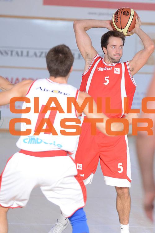 DESCRIZIONE : Porto Sant'Elpidio 3&deg; Torneo della Calzatura Victoria Libertas Pesaro Cimberio Varese<br /> GIOCATORE : Daniele Cavaliero<br /> CATEGORIA : passaggio difesa<br /> SQUADRA : Victoria Libertas Pesaro<br /> EVENTO : Porto Sant'Elpidio 3&deg; Torneo della Calzatura<br /> GARA : Victoria Libertas Pesaro Cimberio Varese<br /> DATA : 15/09/2012<br /> SPORT : Pallacanestro<br /> AUTORE : Agenzia Ciamillo-Castoria/GiulioCiamillo<br /> Galleria : Lega Basket A 2012-2013<br /> Fotonotizia : Porto Sant'Elpidio 3&deg; Torneo della Calzatura Victoria Libertas Pesaro Cimberio Varese<br /> Predefinita :