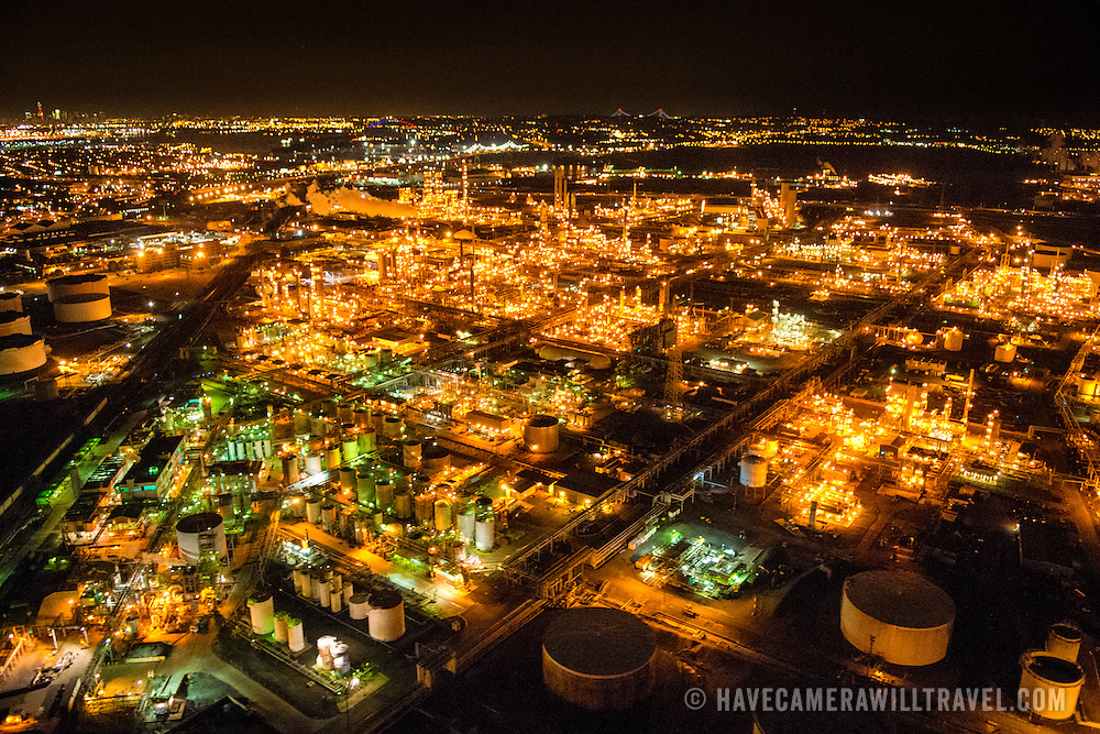 And aerial shot taken from a helicopter at about 500 feet of Bayway Refinery, a crude oil refinery located on the border of Linden and Elizabeth, NJ. The night shot clearly shows the refinery's lights burning brightly. Please note that there is some high ISO noise at full resolution.