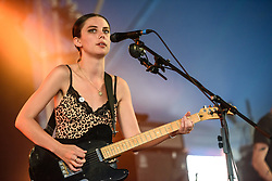 © Licensed to London News Pictures. 26/08/2017. Reading Festival 2017, Reading, UK. Wolf Alice perform a secret early afternoon set.  Ellie Rowsell pictured  Photo credit: Andy Sturmey/LNP