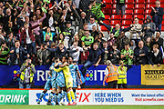 Forest Green Rovers forward Shawn McCoulsky (21) celebrates with teammates after scoring the winning penalty shoot-out goal during the EFL Cup match between Charlton Athletic and Forest Green Rovers at The Valley, London, England on 13 August 2019.