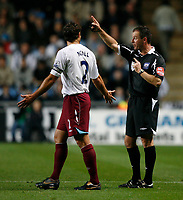 Photo: Steve Bond.<br /> Coventry City v West Ham United. Carling Cup. 30/10/2007. Referee Rob Styles (R) gives a final warning to Lucas Neill (R)
