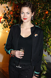 A party hosted by Mario Testino, Bianca Jagger and Kenneth Cole in collaboration with UNFPA and Marie Stopes International to celebrate the publication of Women to Woman: Positively Speaking - a book to raise awareness of women living with HIV/Aids, held at The Orangery, Kensington Palace, London on 2nd December 2004.<br />Picture shows:-Model JASMINE GUINNESS.<br /><br />NON EXCLUSIVE - WORLD RIGHTS