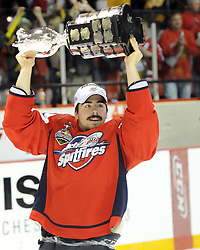 Dale Mitchell hoists the Memorial Cup after the Windsor Spitfires defeated the Brandon Wheat Kings in the championship game at the 2010 MasterCard Memorial Cup in Brandon, MB on Sunday May 23. Photo by Aaron Bell/CHL Images