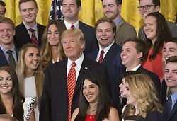 """July 24, 2017 - Washington, District of Columbia, U.S. - President DONALD TRUMP poses for photographs with an outgoing group of interns at The White House. During the photo-op, a reporter asked, """"Mr. President, should Jeff Sessions resign?"""" Trump responded solely with an obvious roll of his eyes, which garnered laughter from the crowd around him. And when the reporter continued, asking about the Republicans' health care repeal bill, Trump looked toward her, raised his chin, and tersely stated, """"Quiet."""" (Credit Image: © Chris Kleponis/CNP via ZUMA Wire)"""