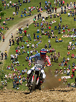 The crowd watches from below as Trey Hagstrom crests the top of Gunstock's Hillclimb on Wednesday.  (Karen Bobotas/for the Laconia Daily Sun)