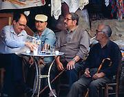 Greece, Crete, men drinking at taverna in Iraklion.