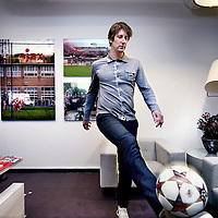 Nederland, Amsterdam 22 november 2013. ,<br /> Edwin van der Sar (Voorhout, 29 oktober 1970) is de directeur marketing van AFC Ajax. Van der Sar speelde tussen 1990 en 2011 zelf profvoetbal als doelman voor Ajax, Juventus, Fulham en Manchester United en kwam, als recordinternational, 130 keer uit voor het Nederlands voetbalelftal.<br /> Op de foto: Edwin van der Sar trapt een balletje op zijn kantoor in de Ajax Arena stadion.<br /> Former professional football player and goalkeeper Edwin van der Sar is the marketing director of AFC Ajax.