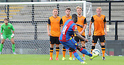 Sullay KaiKai curls in a freekick to equalise for Palace during the Final Third Development League match between U21 Crystal Palace and U21 Hull City at Selhurst Park, London, England on 10 August 2015. Photo by Michael Hulf.
