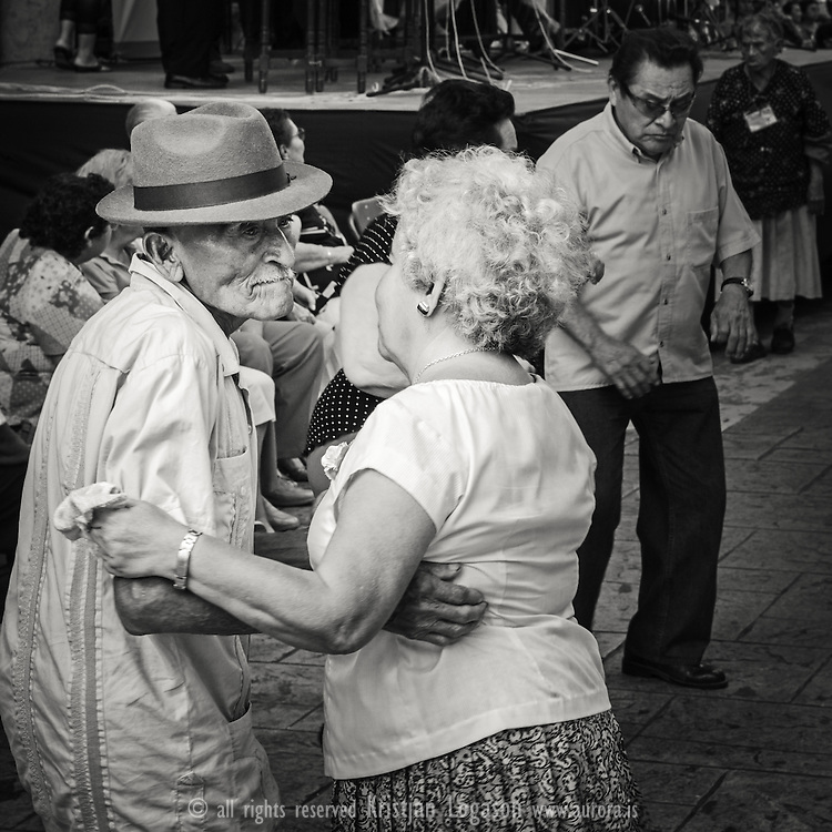 Old couple dancing at the central square of Merida, Mexico to the music of a local band